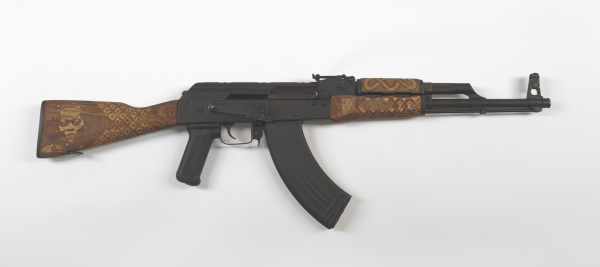 """Couture Africana AK-47 No. 1″ Digital Photograph of AK-47 Rifle with Hand Carved Furniture and Diamond Encrusted Sites, 2010, 42×18″"