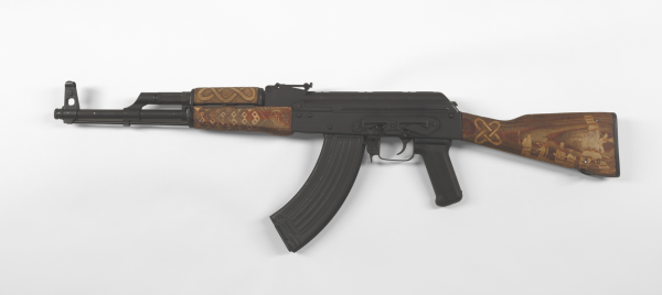 """Couture Africana AK-47 No. 2″ Digital Photograph of AK-47 Rifle with Hand Carved Furniture and Diamond Encrusted Sites, 2010, 42×18″"