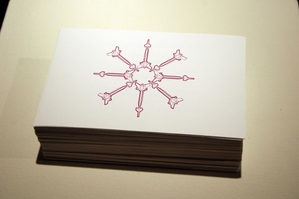 """Cluster Bomb Snowflake Gift Print/Invite"" (detail) stacked silkscreen edition of 500, 2007, 8.5 x 5.5 x 7″"