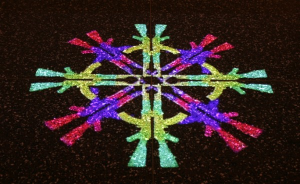 """AK-47 Mandala"" digital animation containing 96 color variations, floor projection, 2007, 4.5 x 4.5'"