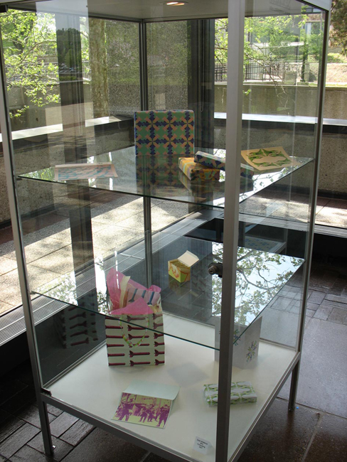 """Gift Installation"" pigment print constructions, various wrapped objects, 2007, Installation View"