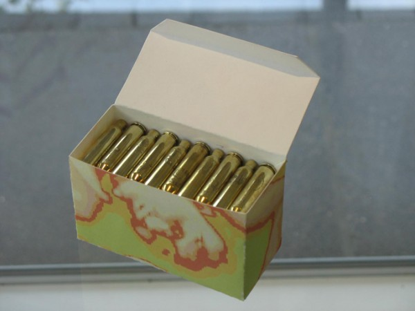 """Baghdad Gift Box"" pigment print construction, 60 engraved shell casings, 2007, 4x2x2″"