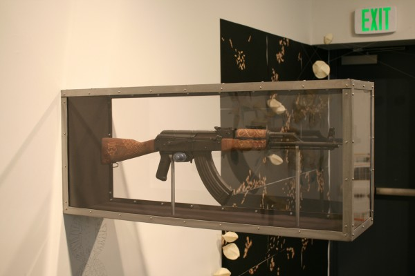 """Couture Africana AK-47″ AK-47 Rifle with Hand Engraved Furniture and Diamond Encrusted Sites, Steel and Shatter Proof Security Box, 40x19x12″, 2010"