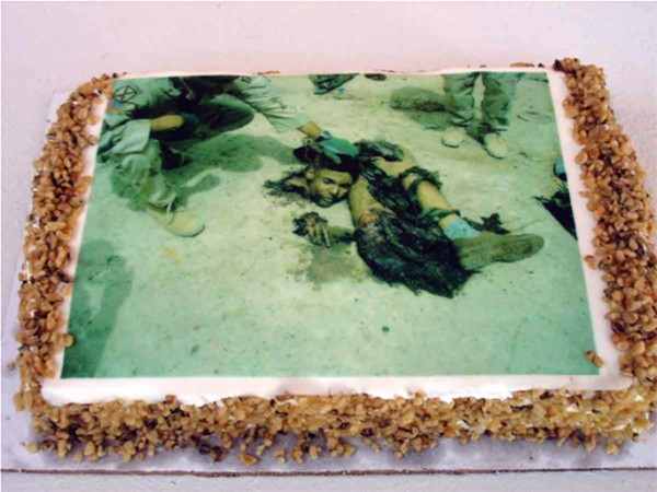 """""""Let Us Eat Cake No. 1″ edible digital print of censored image from Iraq on carrot cake, 2006, 12 x 9 x 3″"""