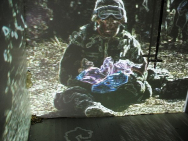 """Field Notes Installation Still""  Photograph on Paper of Video Performance, 15X11″, 2009"